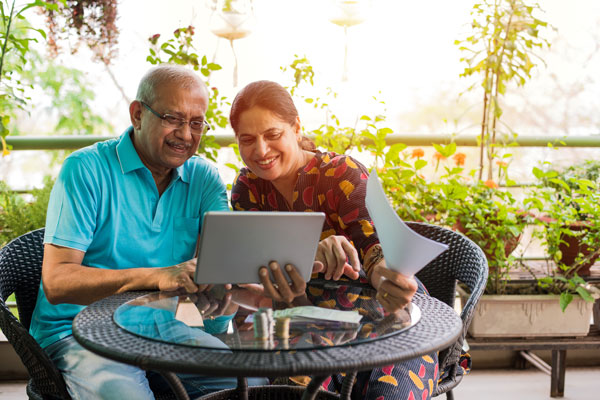 Couple looking at tablet computer