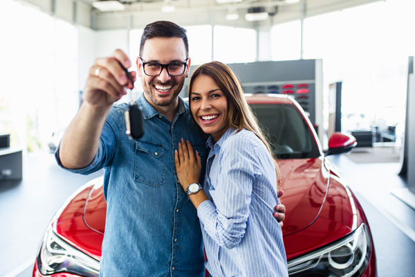 Couple posing with car keys